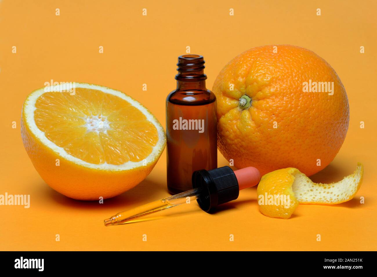 Oranges, halved with peel, orange oil in bottle with pipette, Germany Stock Photo