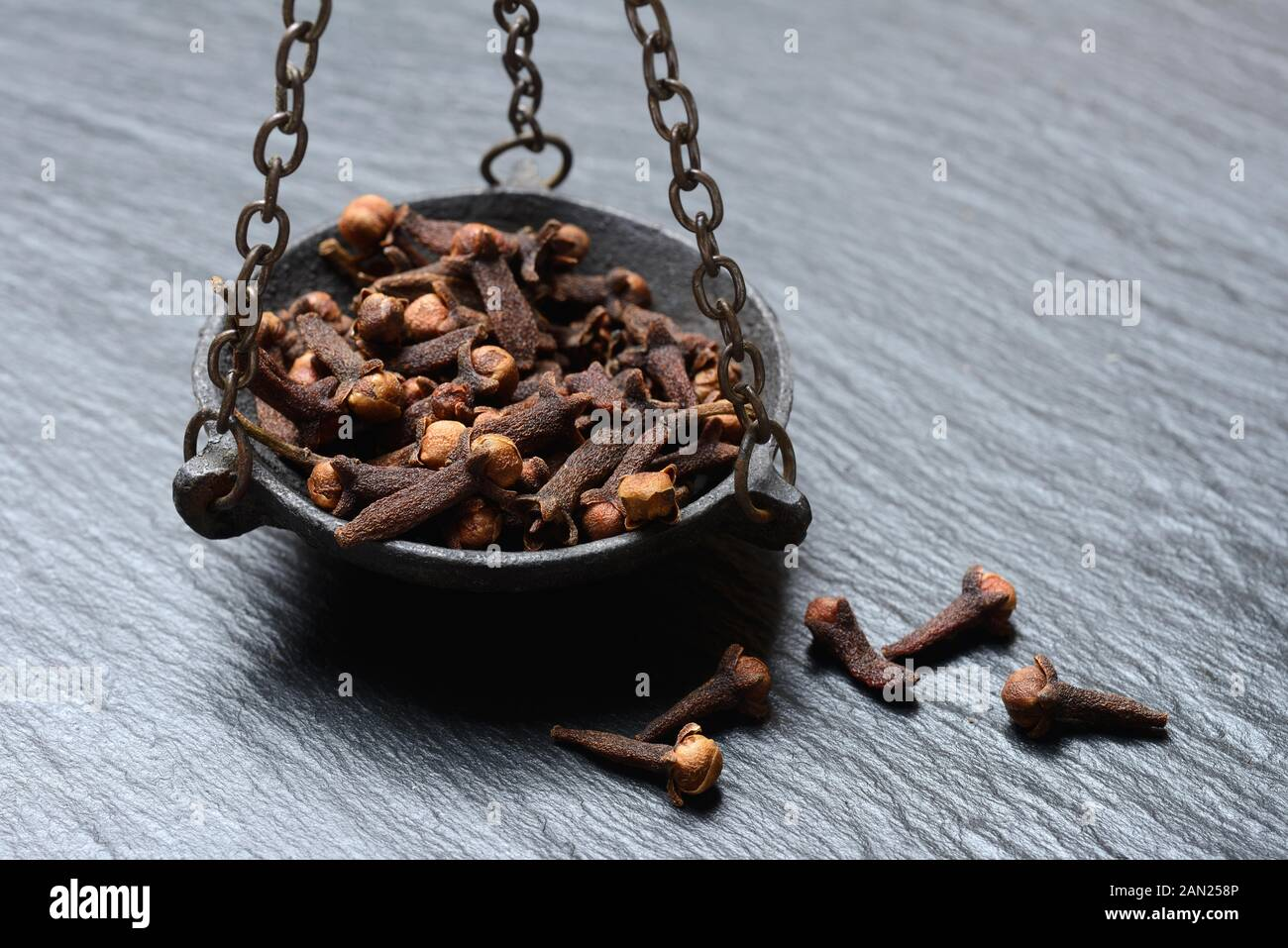 Cloves in a weighing pan, Germany Stock Photo