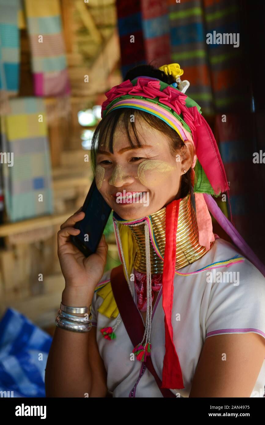 A Padaung woman using her smartphone. Stock Photo