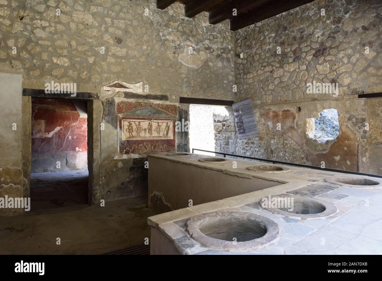 Pompei. Italy. Archaeological site of Pompeii. House and Thermopolium of Vetutius Placidus on via dell'Abbondanza (Casa e Thermopolium di Vetutius Pla Stock Photo