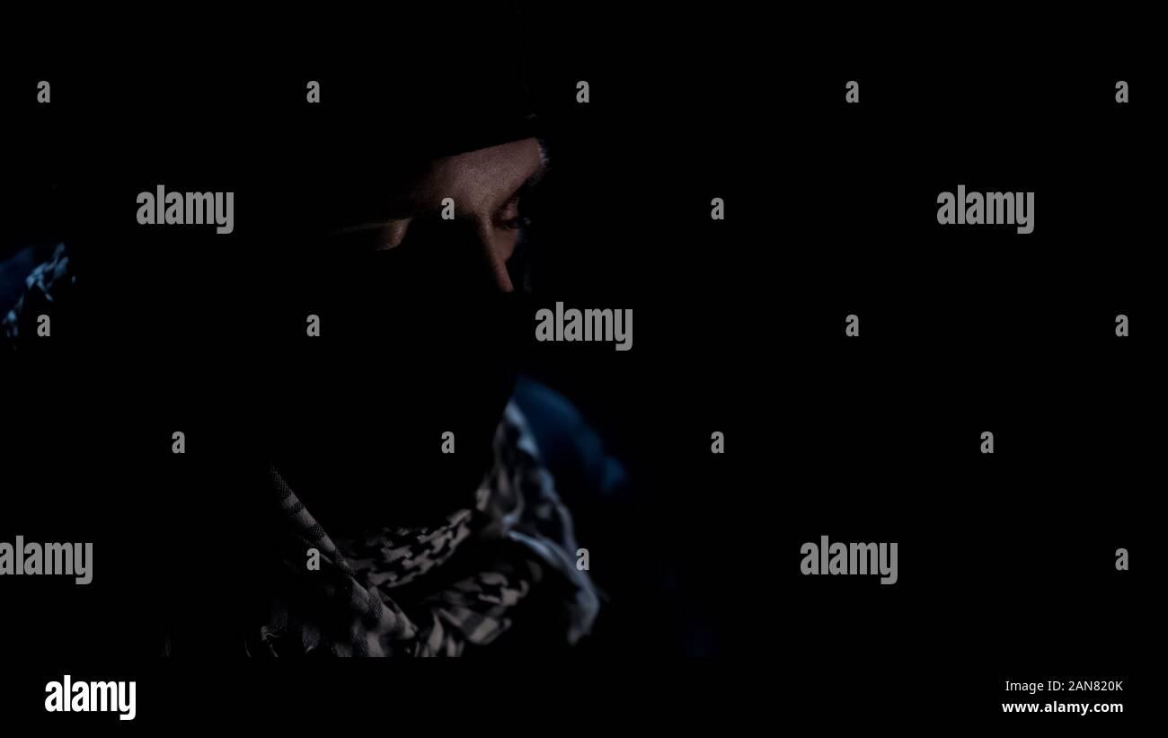Bomber closed eyes, praying before suicide, militant Islamist organization Stock Photo