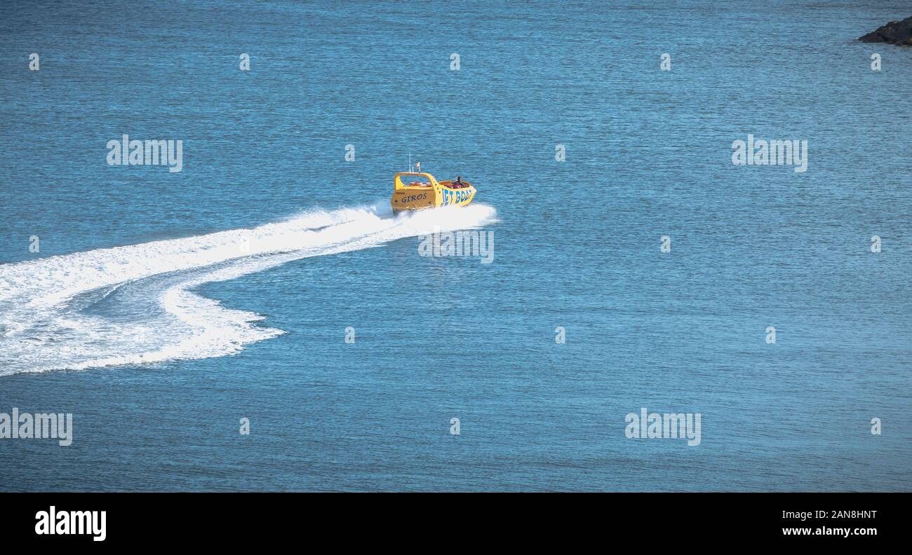 Albufeira, Portugal - May 3, 2018: Jetboat for tourists entering the harbor at full speed on a spring day Stock Photo