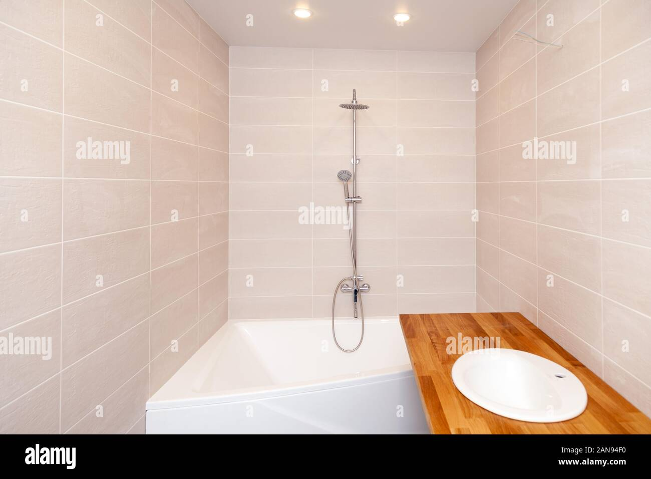 Empty New Bathroom With Beige Ceramic Rectangular Tiles Large