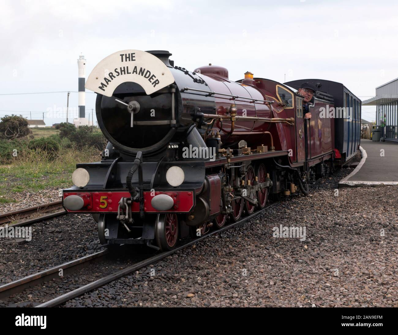 Mountain-type locomotive, Hercules, pulling a passenger train out of Dungeness Station, on the Romney, Hythe & Dymchurch Railway Stock Photo