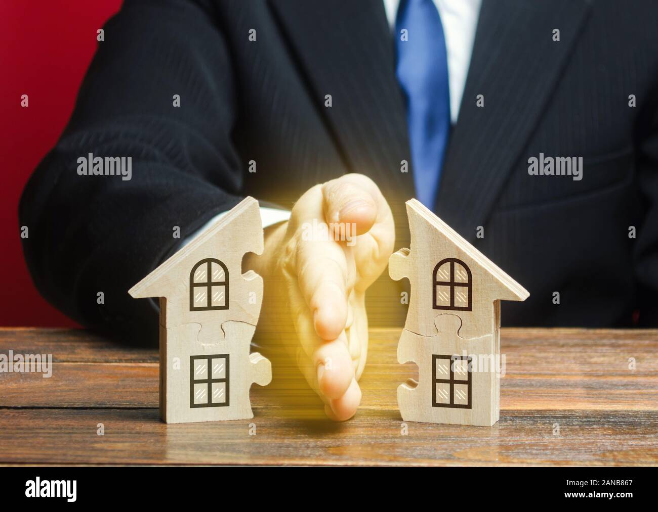 Lawyer divides the house into two equal parts in a divorce process. Protection of rights. Conflict resolution. Court, justice. Disputes over fair divi Stock Photo