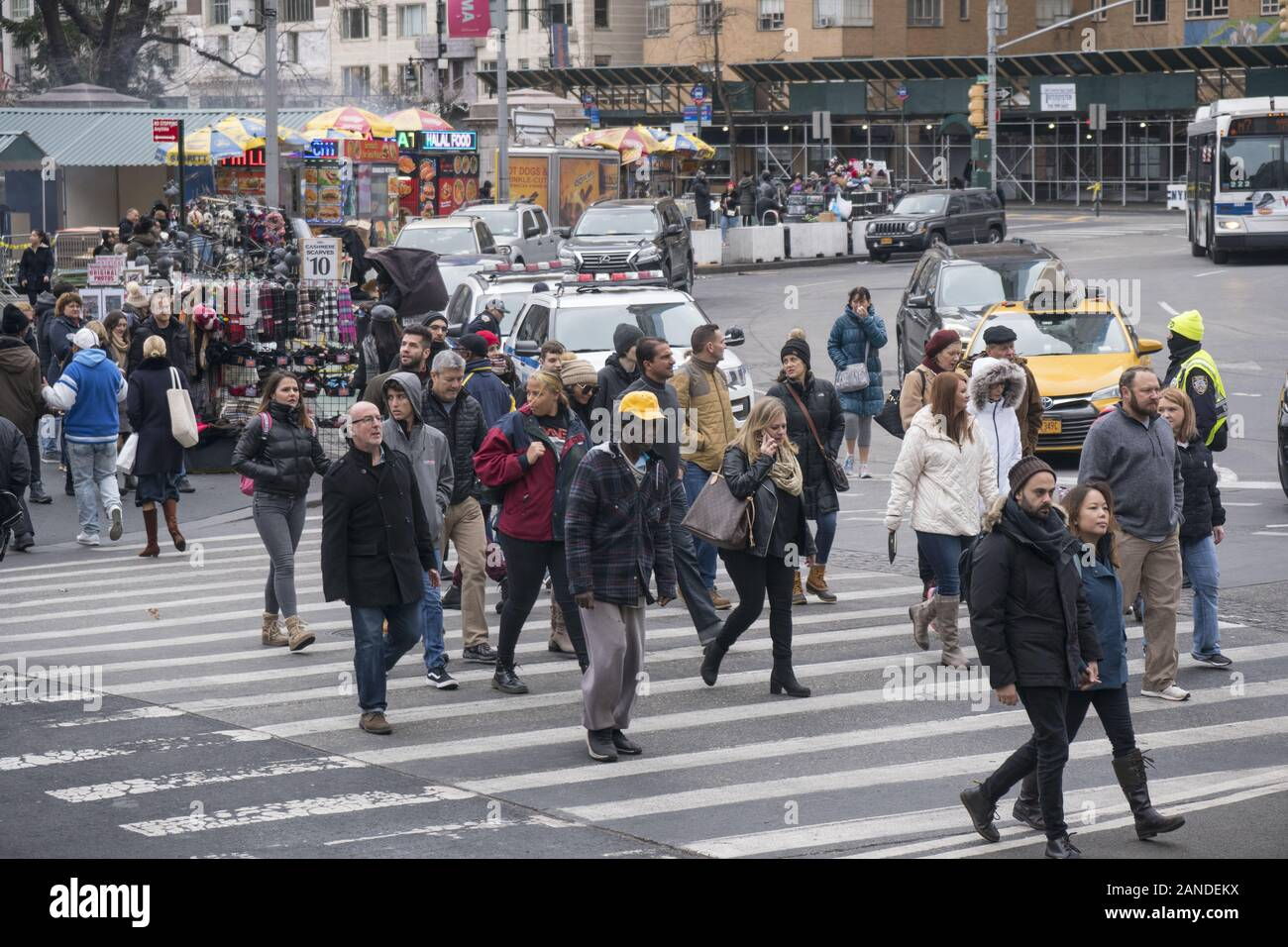 People in the crosswalk at Columbus Circle and 60th Street at Central Park, New York City. Stock Photo