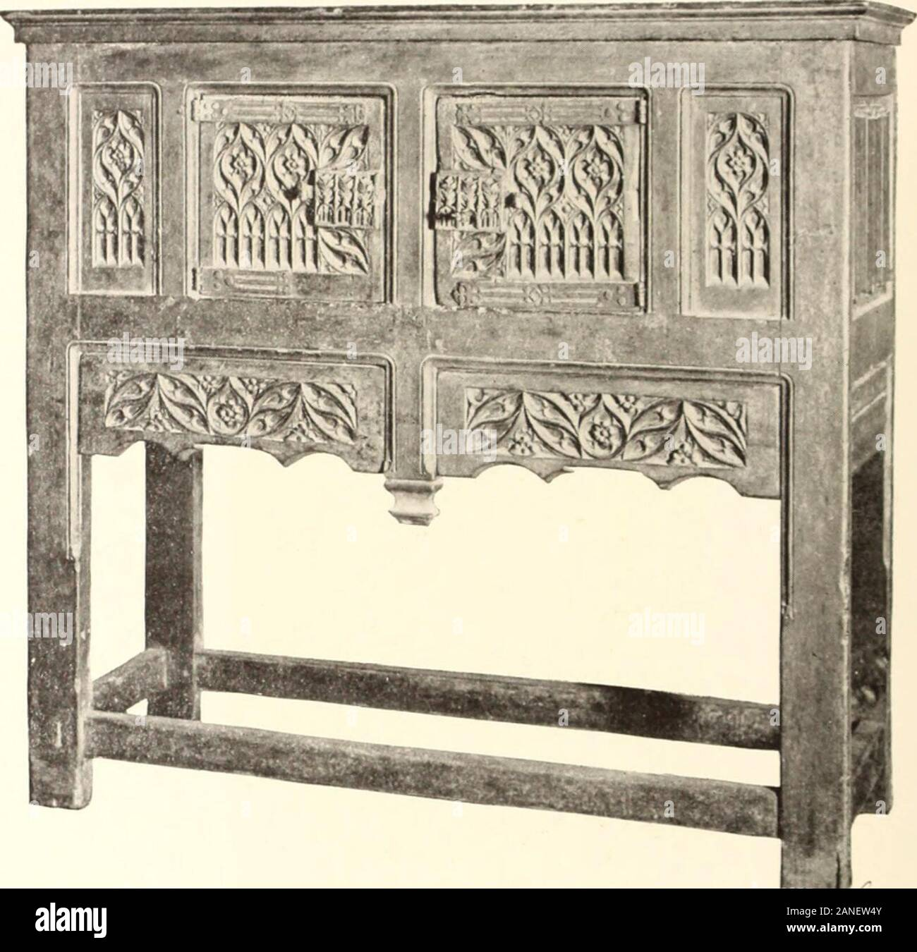 Illustrated catalogue of the exceedingly rare and valuable art treasures and antiquities formerly contained in the famous Davanzati Palace, Florence, Italy . 420—Sixteenth Century Ligurian Walnut Cabinet^Rectangular shape, divided horizontally into two parts. The / upper part, with deep molded cornice, is arranged into two cup-boards with hinged raised panel doors decorated in paintedchiaroscuro work, with shaped bronze keyhole escutcheons, andseparated by three pilaster-like panels richly carved, in a designof scrolled strapwork and oval medallions. The lower portion,separated by a heavy mold Stock Photo