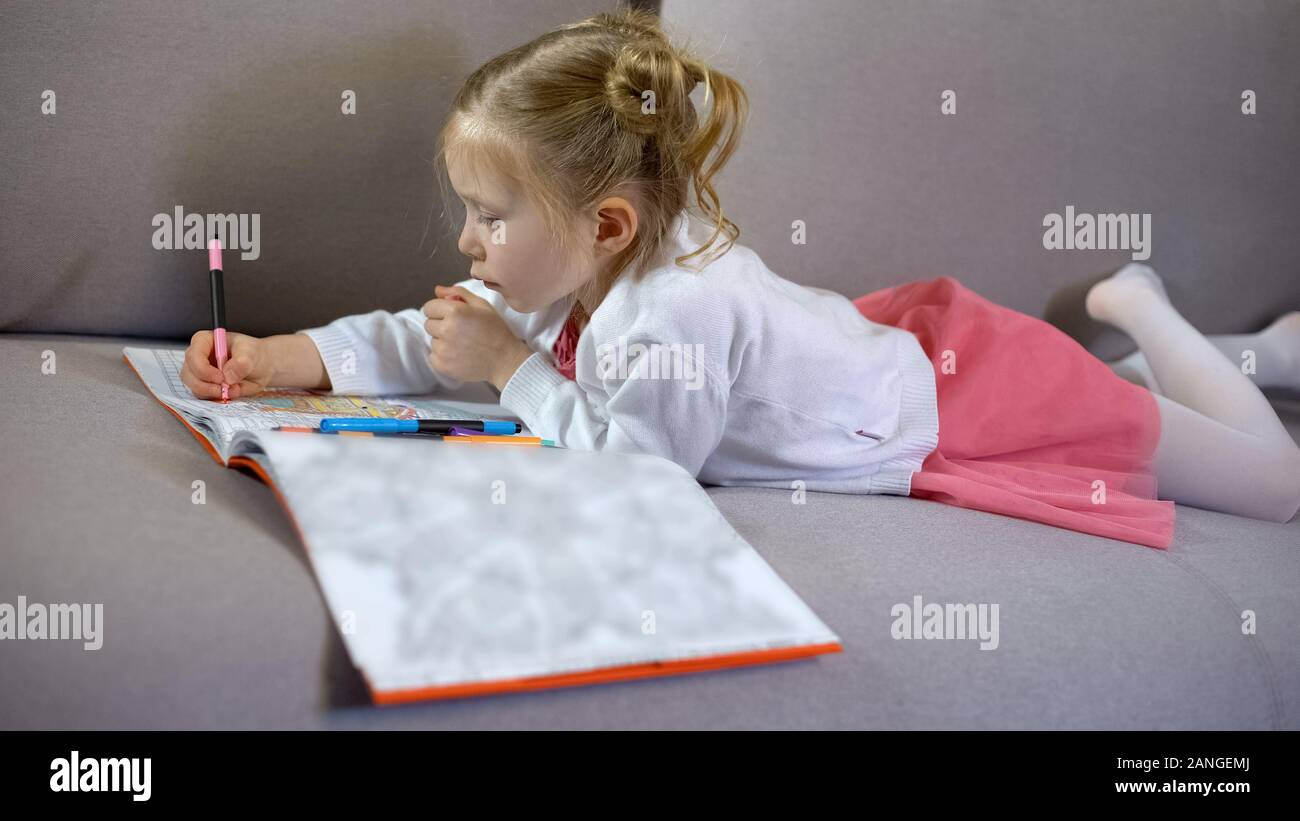 Cute Little Girl Drawing With Markers In Coloring Book Art Therapy And Hobby Stock Photo Alamy