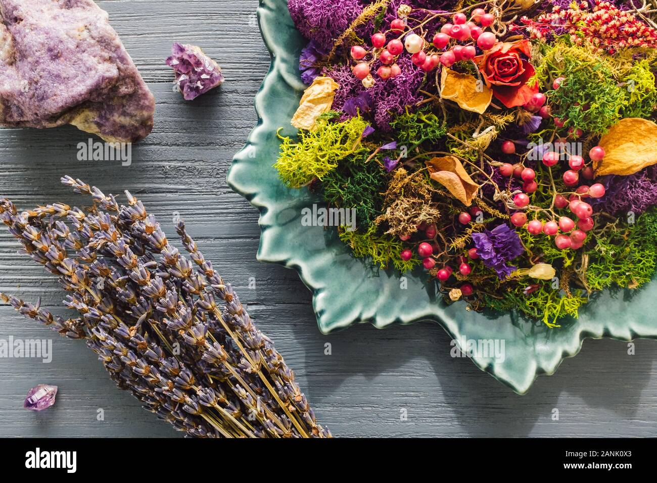 Plate of Dried Botanicals with Lepidolite and Amethyst Crystals Stock Photo