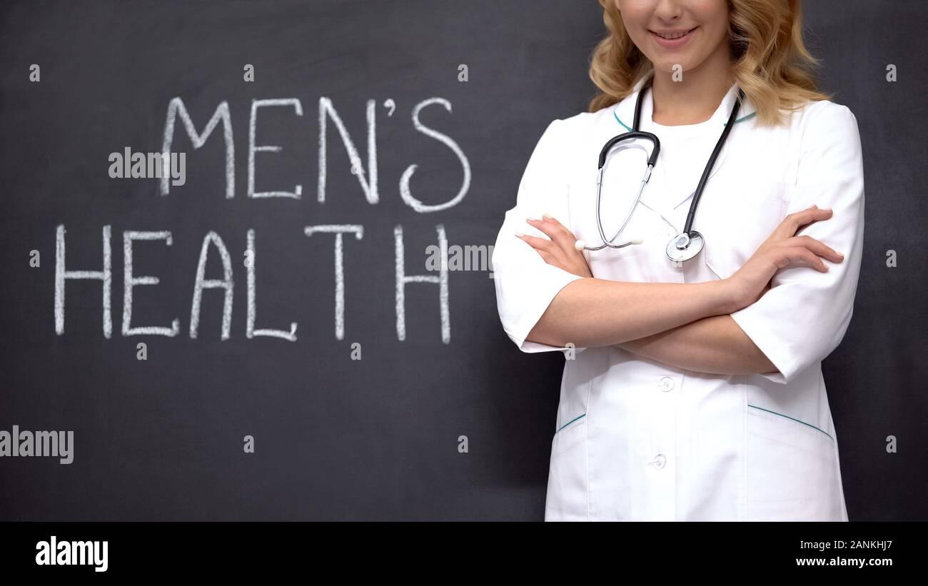 Urologist standing near Mens health words, medical exam to prevent prostatitis Stock Photo