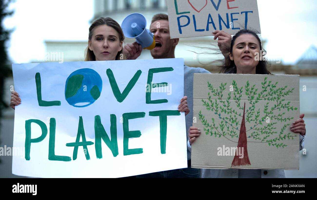 Young people chanting slogans about planet ecology, deforestation problems Stock Photo