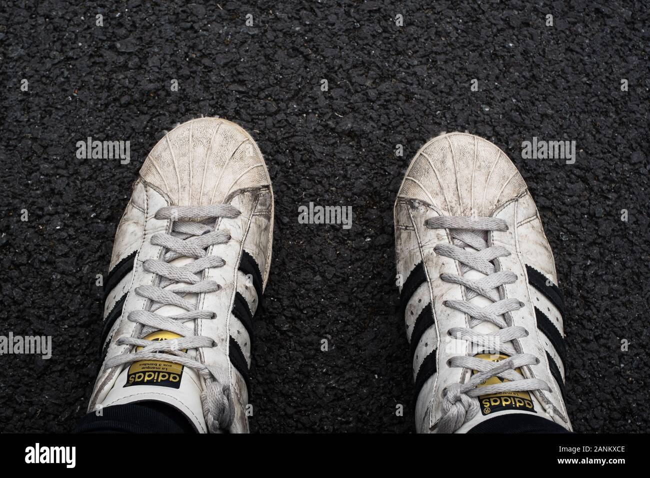 background floor striped black white against trainers adidas