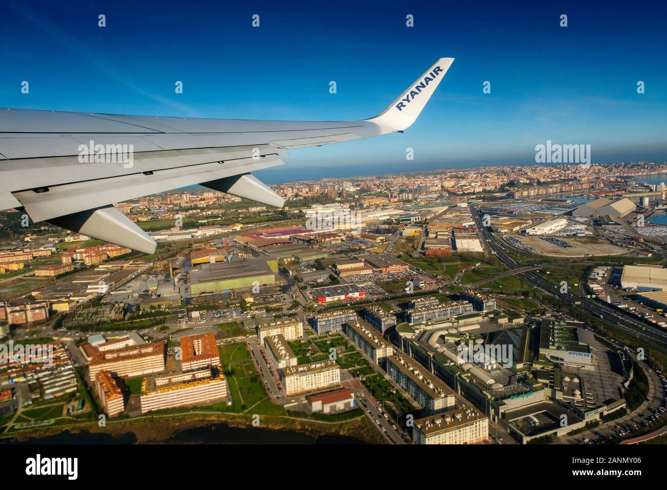 Plane flying over Santander, Cantabrian Sea. Cantabria, north Spain. Europe Stock Photo