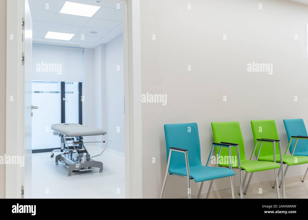 Esthetic And Clean Modern Private Massage Skin And Nail Care Salon Massage Table In Clinic Room Visible From Waiting Room Stock Photo Alamy