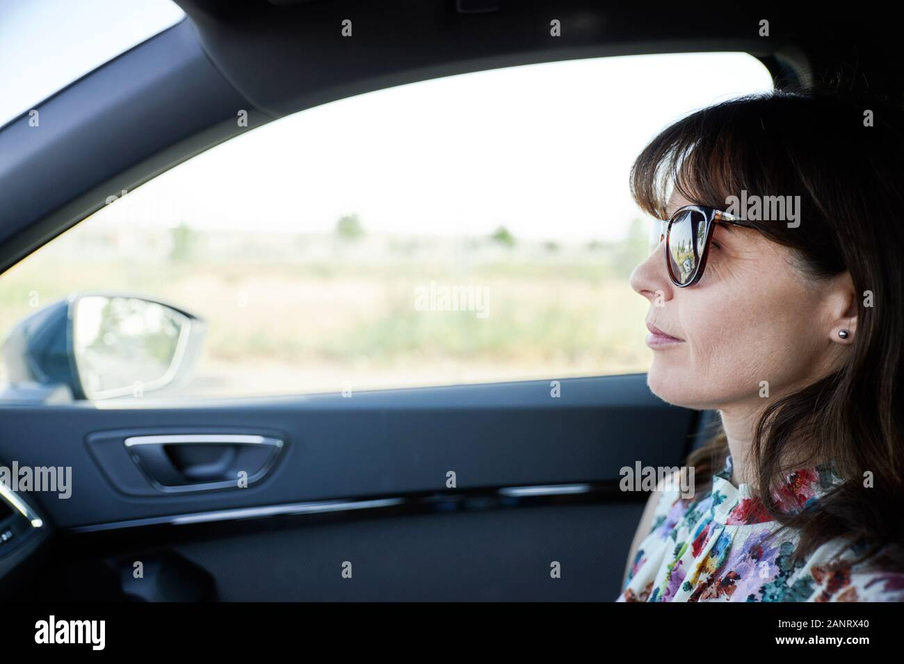 happy woman traveling in a car. Concept of travel Stock Photo