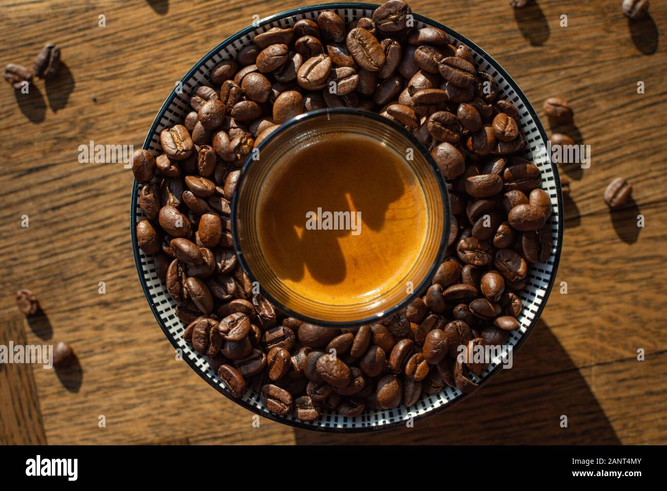 Top Down Coffe Shot Of Coffe Beans In Bowl With Espresso Crema In Center With Natural Light Stock Photo Alamy