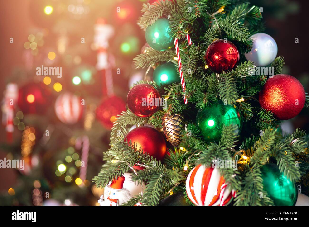 Decorated European American Christmas Tree Red And Green Color Close Up Of Toys And Decor Striped Candy Stock Photo Alamy