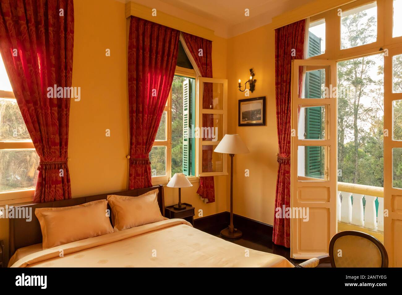 Interior Of French Colonial House Featuring A Beautiful Bedroom In Afternoon Light With Original Furniture Stock Photo Alamy