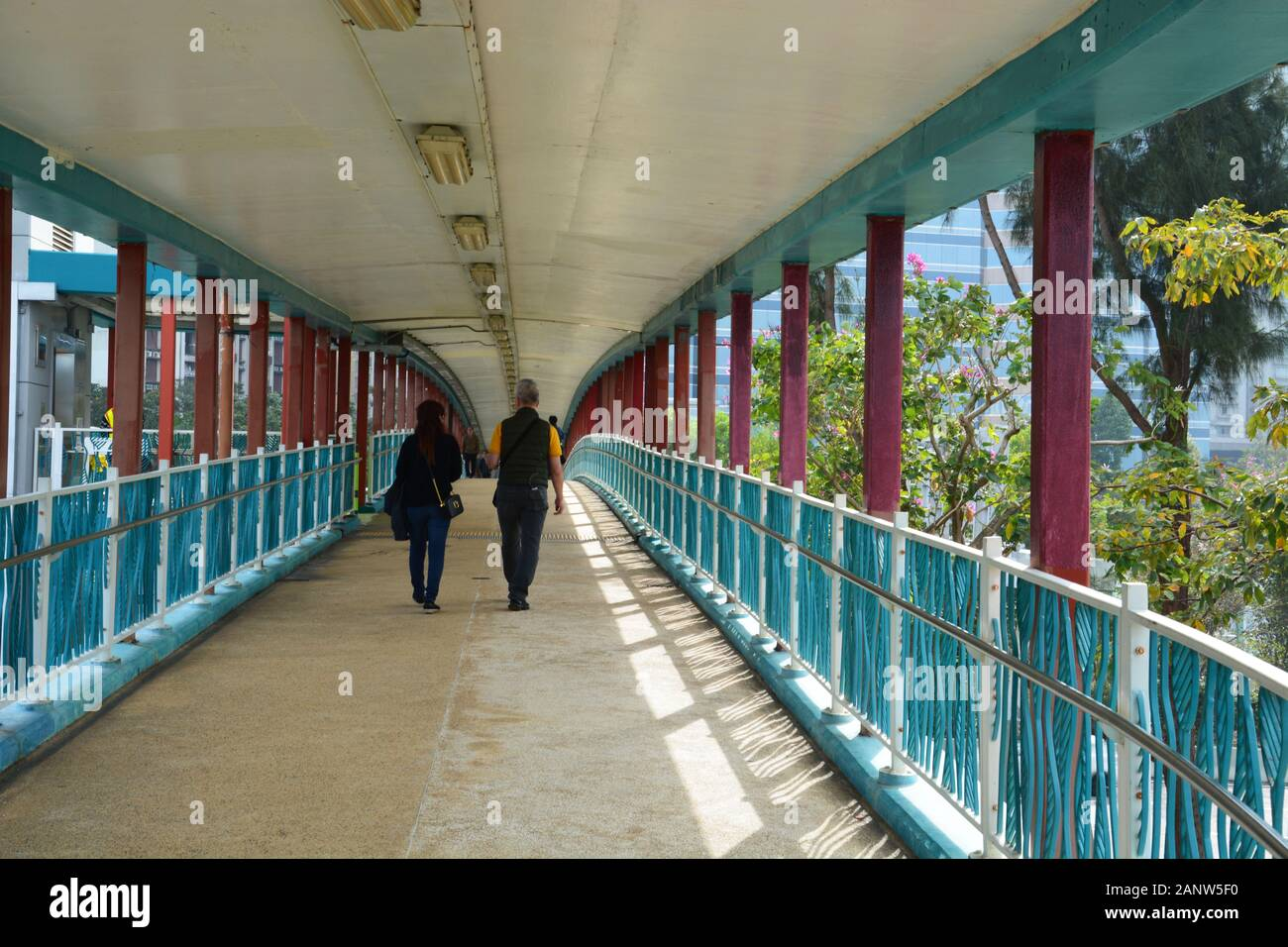 The pedestrian overpass at Quarry Bay Park along Victoria Harbour in Hong Kong. Stock Photo