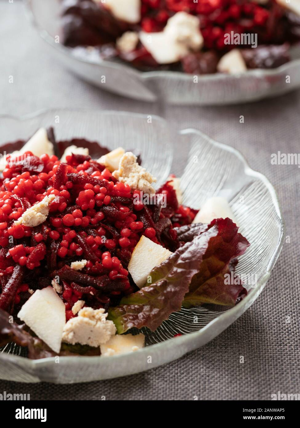 Shoestring Beets with Pearl Couscous and Pears Stock Photo