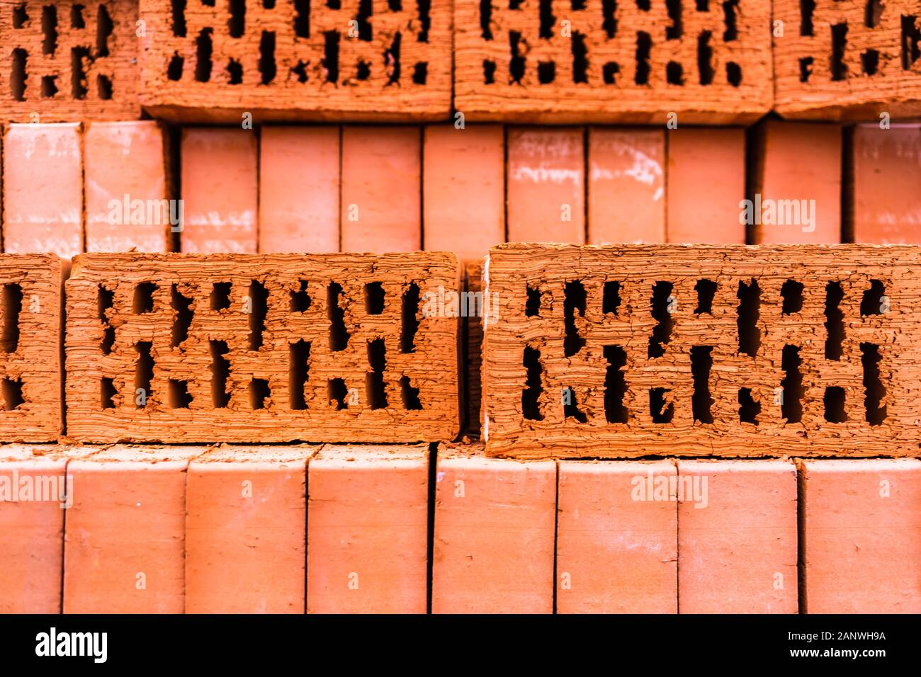Pile of bricks texture wallpaper. Red bricks pile stacked for construction Stock Photo