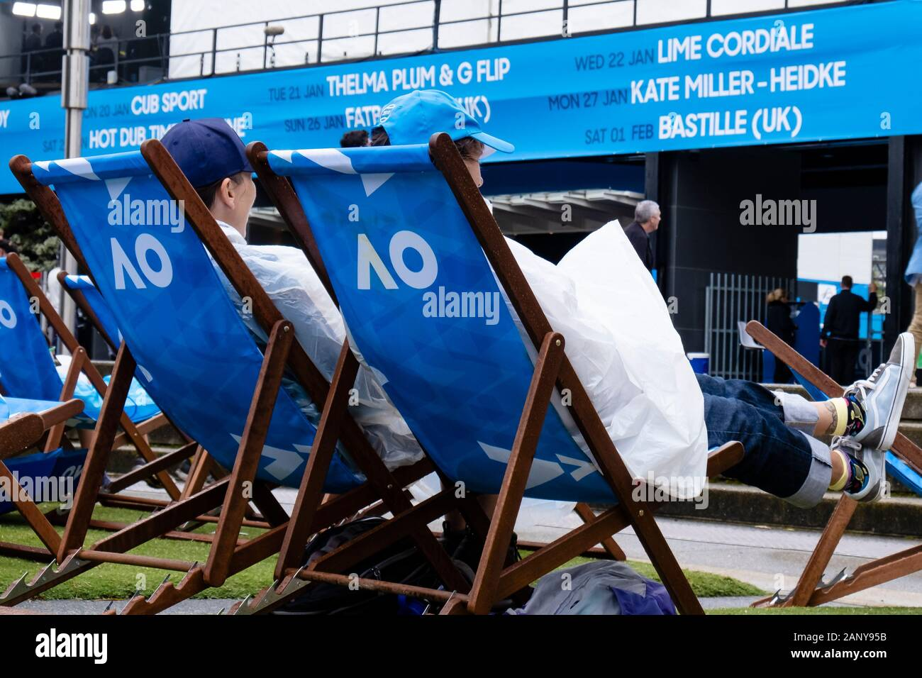 Melbourne, Australia. 20th Jan, 2020. Tennis: Grand Slam, Australian Open. Spectators sit in rain ponchos on the tournament grounds. Heavy rain and thunderstorms have swept over parts of the fire zones in south-east Australia. Credit: Frank Molter/dpa/Alamy Live News Stock Photo