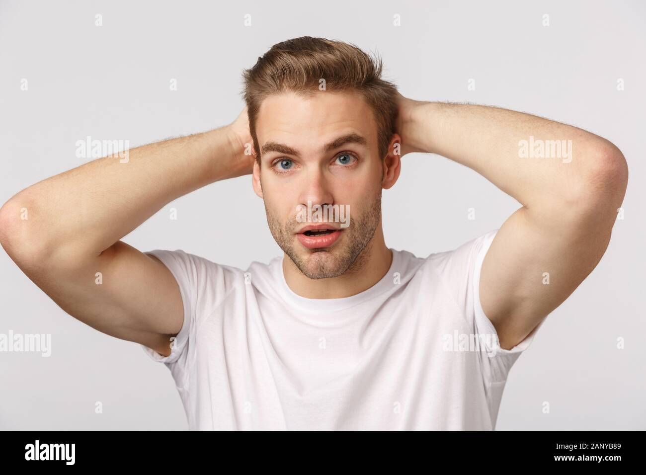 Concerned And Troubled Nervous Young Handsome Blond Guy Feel Anxious Before Important Interview Or Casting Hold Hands Behind Head Look Indecisive Stock Photo Alamy