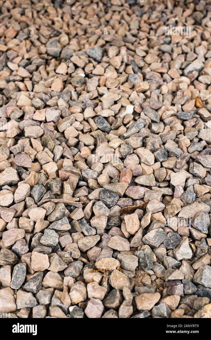A Vertical Closeup Shot Of A Gravel Ground Perfect For A Cool