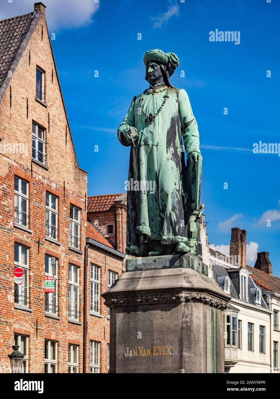 25 September 2018: Bruges, Belgium - Statue of the 15th century painter, Jan van Eyck, standing in the square which bears his name in Bruges. Stock Photo