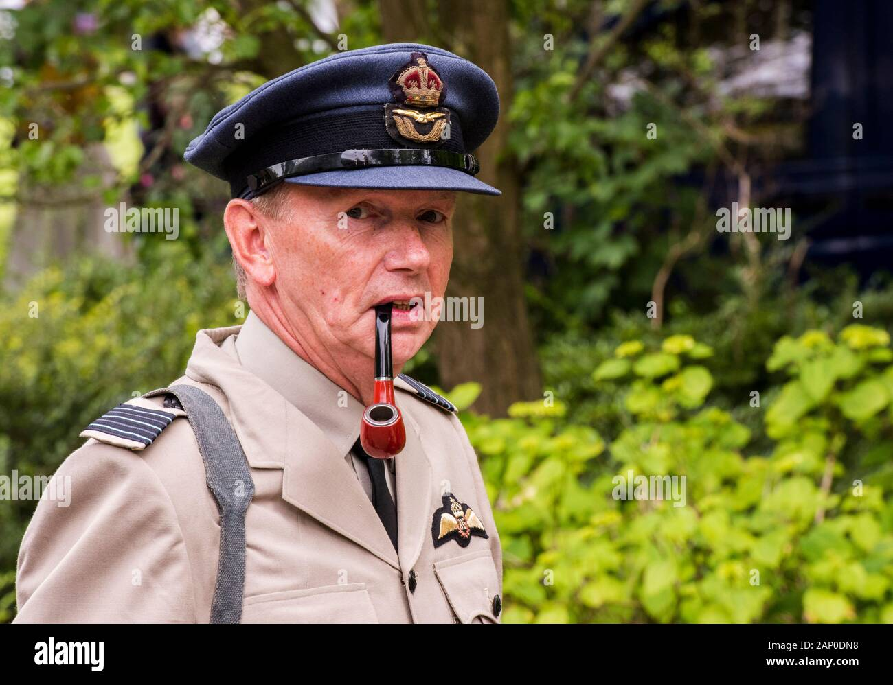 Man in military uniform smoking pipe in Valley Gardens on 1940s Day in Harrogate in England. Stock Photo