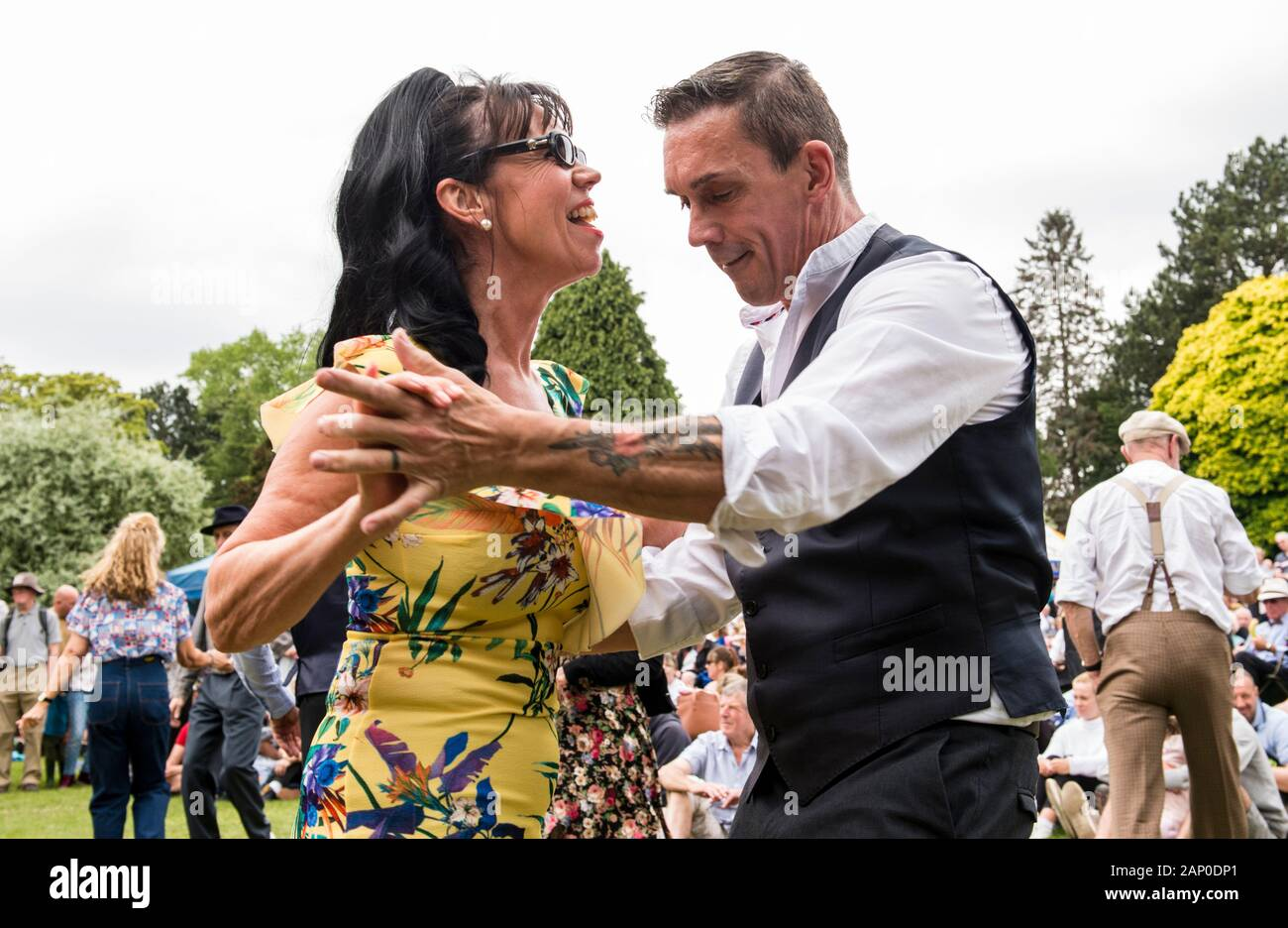 Couple swing dancing in Valley Gardens on 1940s Day in Harrogate in England. Stock Photo