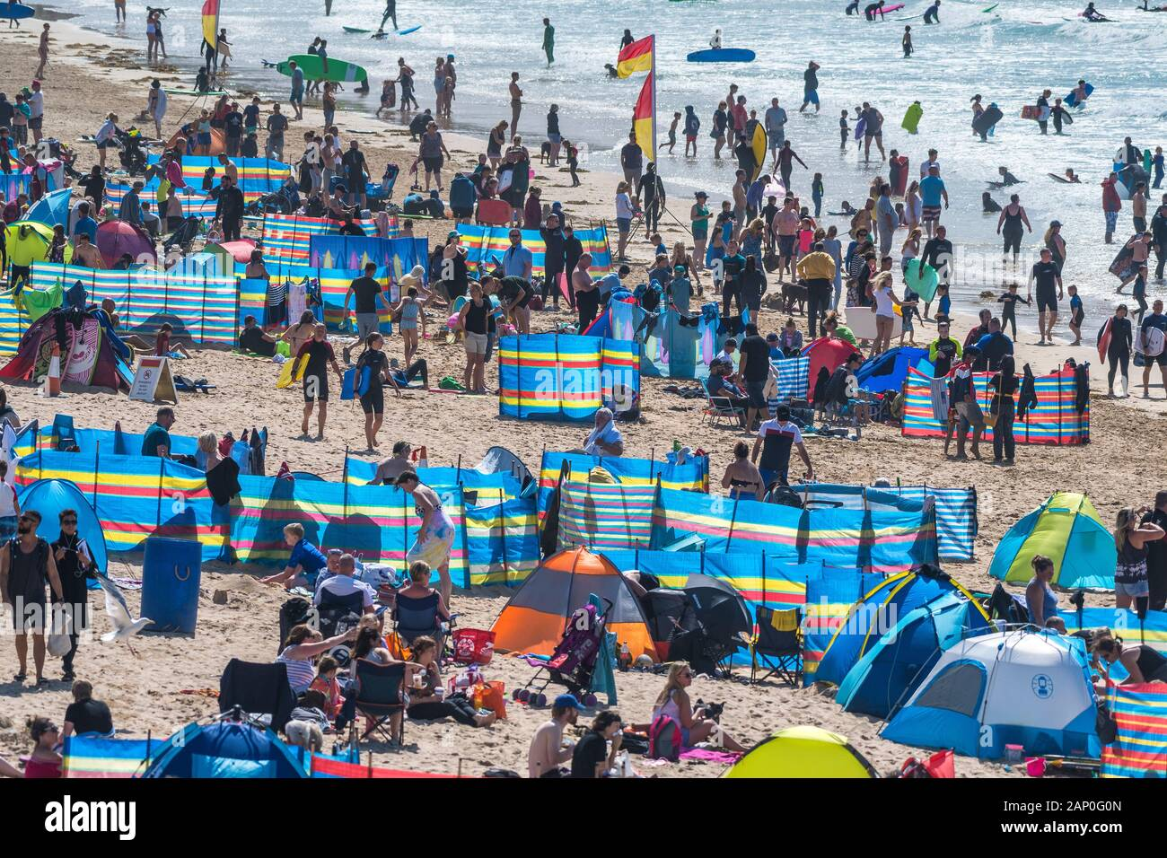 Holidaymakers enjoying themselves on Fistral Beach in Newquay in Cornwall. Stock Photo