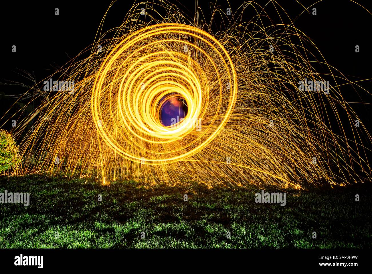 Firework, made by spinning burning wire wool in an egg whisk. Stock Photo