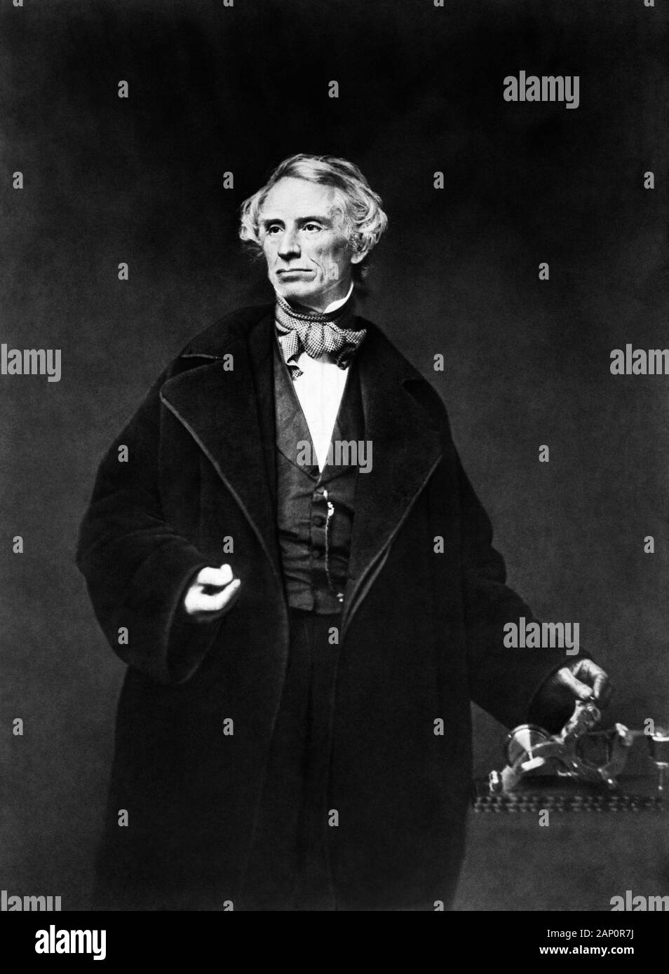 Vintage portrait photo of American painter and inventor Samuel F B Morse (1791 – 1872) – a pioneer in the development of the electric telegraph and co-creator of Morse Code. Photo circa 1855 by Mathew B Brady showing Morse with his hand on a telegraph apparatus. Stock Photo