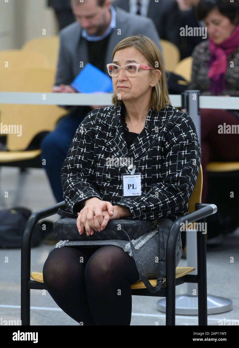 Madrid, Spain. 20th Jan, 2020. Mossos d'Esquadra's intendent, Teresa Laplana, sit on the dock for the first session of their trial for herinvolvement in the organization of Catalan pro-independent referendum held 01 October 2017, at Audiencia Nacional Court, in Madrid, Spain, 20 January 2020. Three of the defendants are accused of rebellion and Teresa Laplana is accused of sedition for their involvement in the so-called Catalan 'proces'. Credit: Fernando Villar POOL/EFE/Alamy Live News Stock Photo