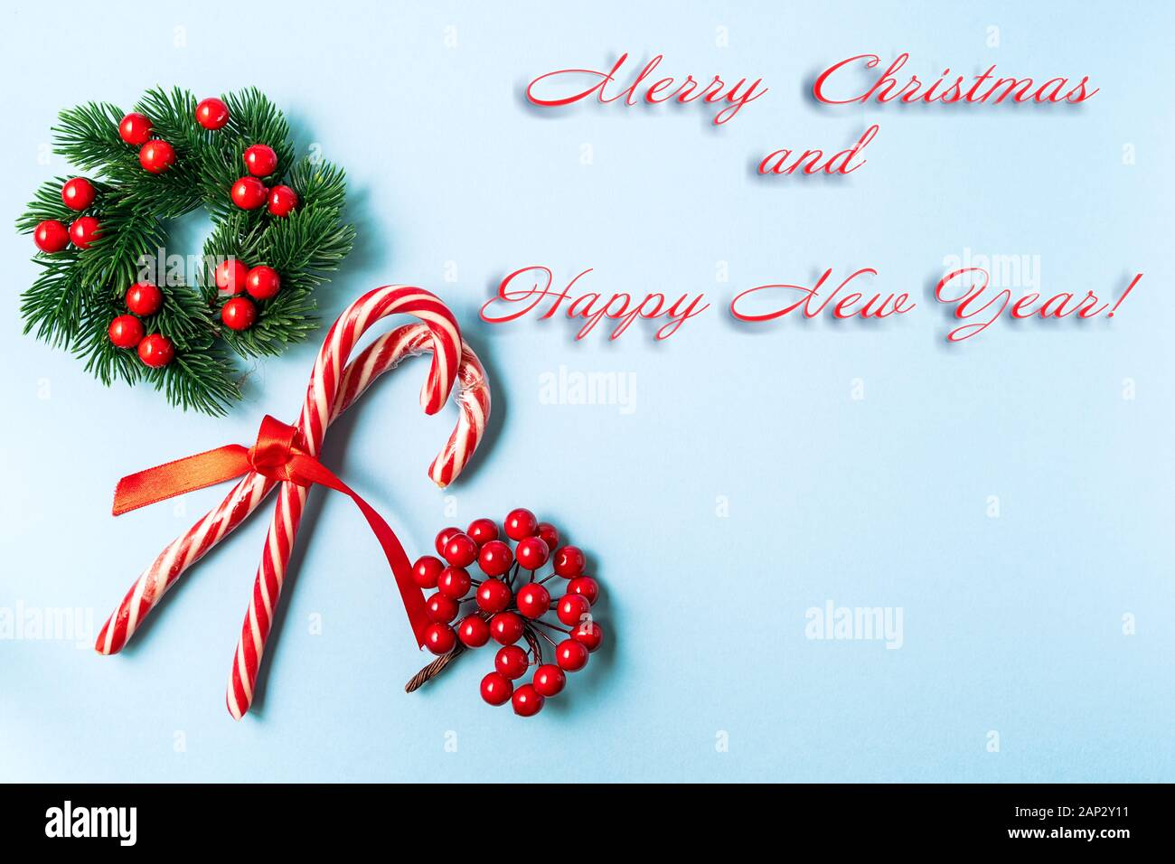 Festive Christmas And New Year Greeting Card With Christmas Candy Cane Red Bow And Christmas Wreath On Blue Background Stock Photo Alamy