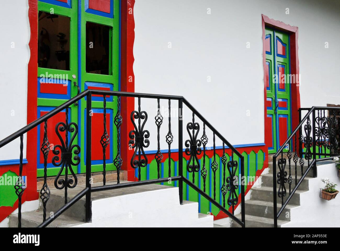 Colorful Doors Stairs And Wrought Iron Railing Of A Whitewashed Home In The Coffee Triangle Town Of Salento Quindio Department Colombia Stock Photo Alamy