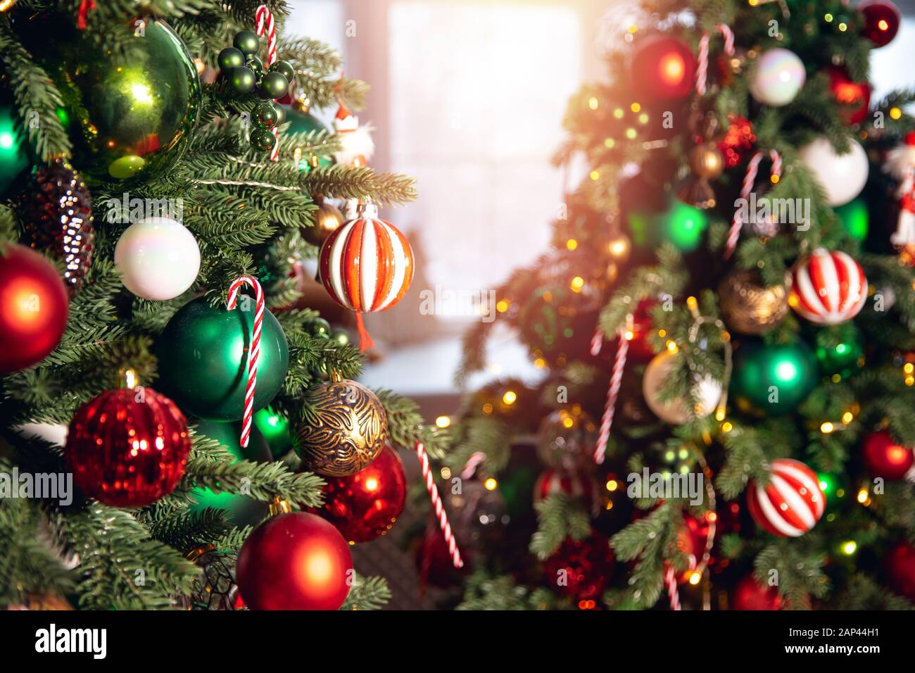Decorated Christmas Tree Red And Green Color Close Up Of Toys And Decor Striped Candy Stock Photo Alamy