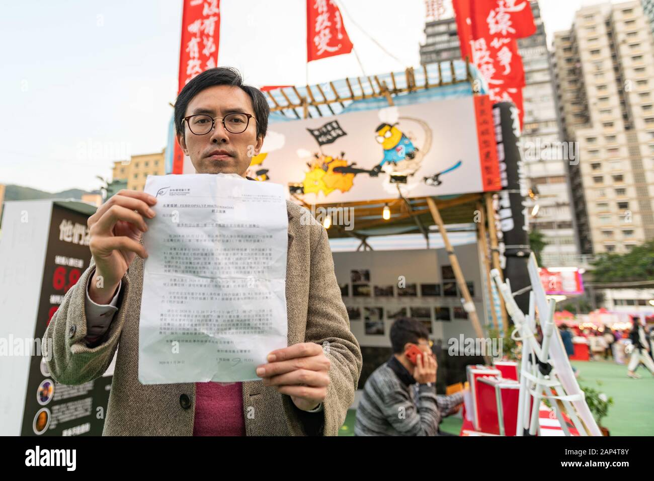 January 20, 2020, Hong Kong, Hong Kong, China: Clayton Ng shows a notice received from the Hong Kong Food and Enviromental Hygine Department that stated that a stall that was set up at the Lunar New Year Festival at Victoria Park must be taken down. (Credit Image: © Tyler Tomasello/ZUMA Wire) Stock Photo