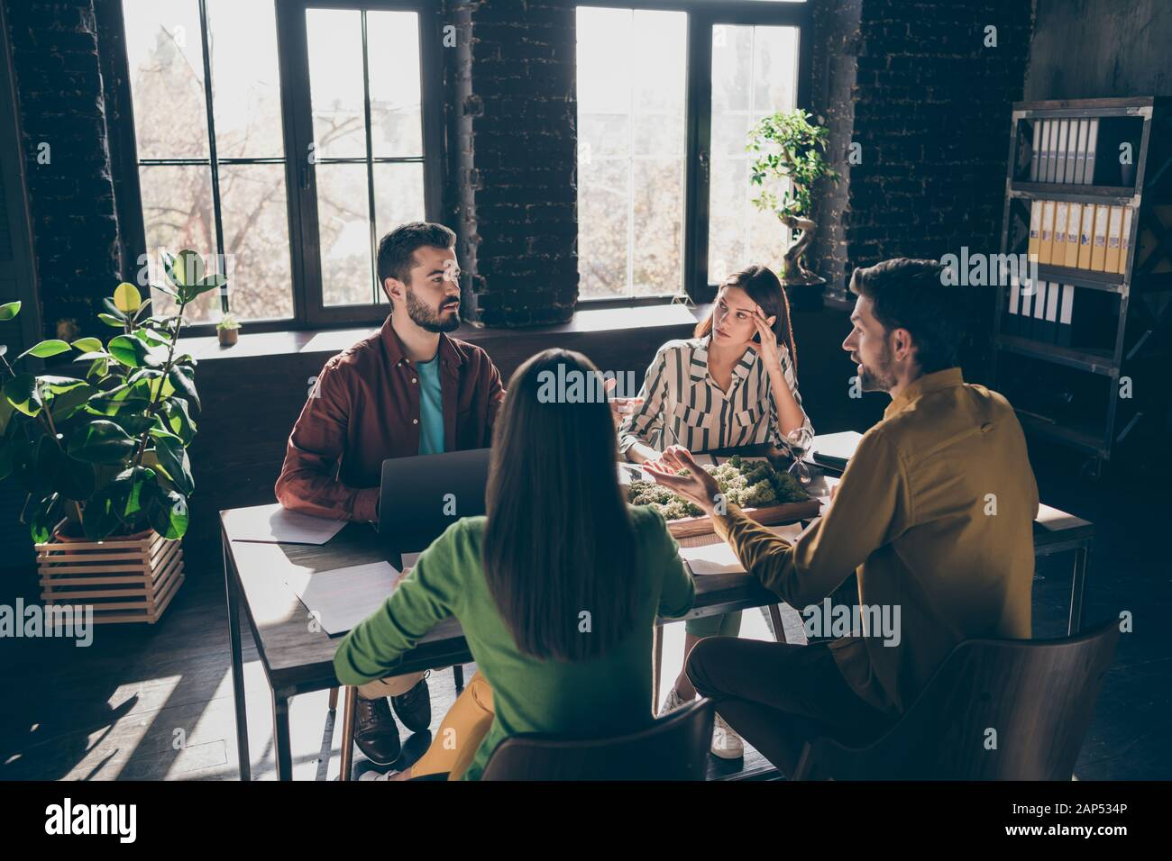 Skilled professional experienced businesspeople specialists sharks experts financier wearing casual formal-wear discussing IT contract at modern Stock Photo