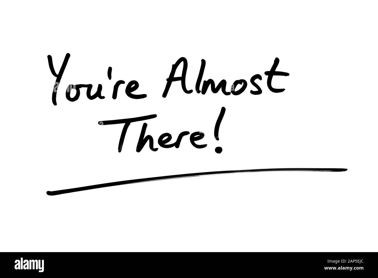 You're Almost There! handwritten on a white background. Stock Photo