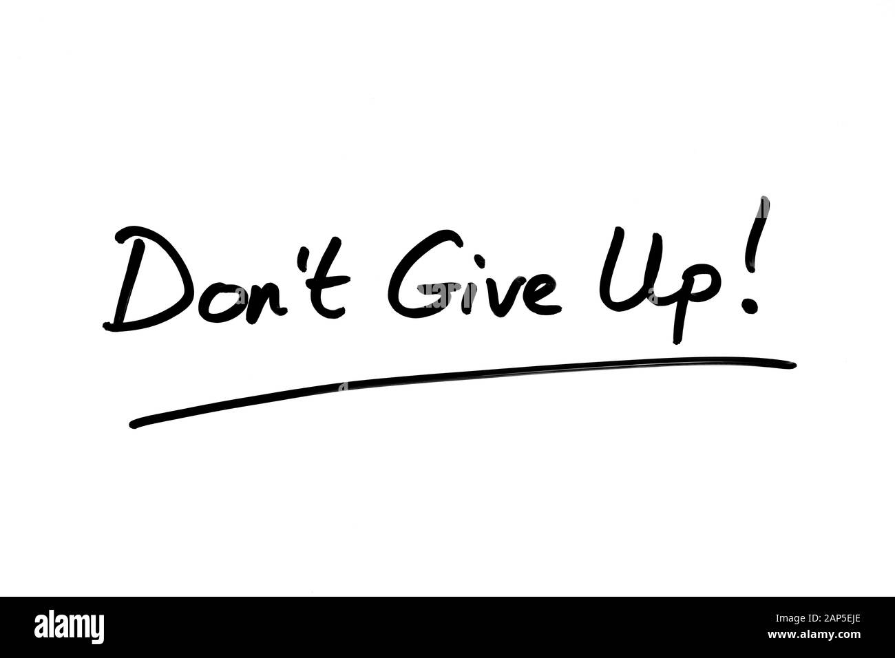 Don't Give Up! handwritten on a white background. Stock Photo