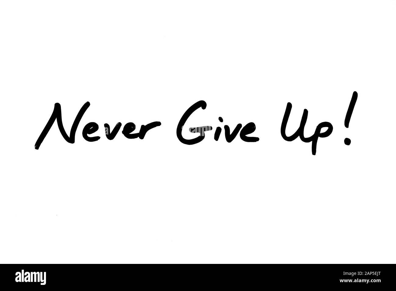 Never Give Up! handwritten on a white background. Stock Photo