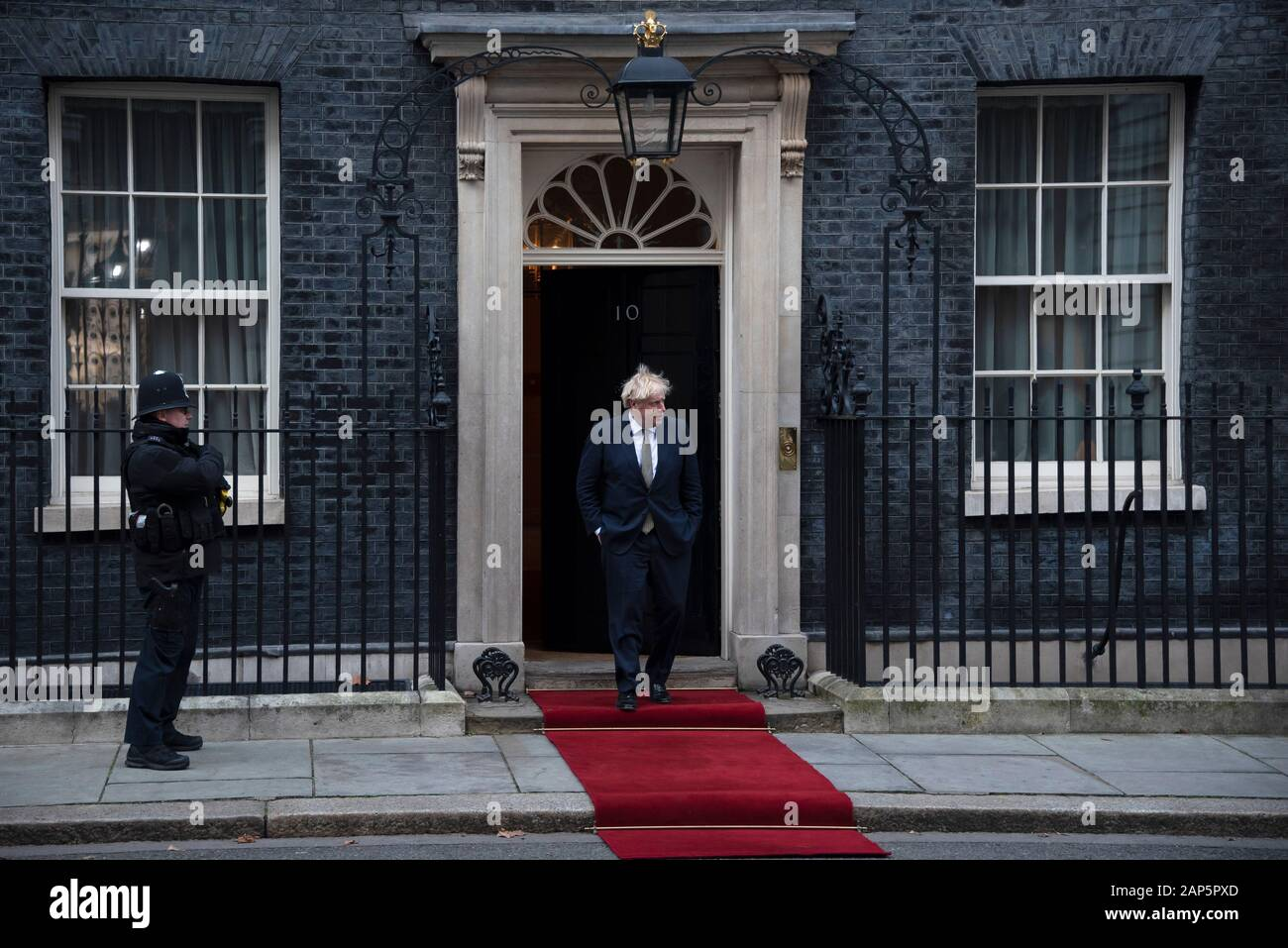 London, UK. 21st Jan, 2020. Prime Minister Boris Johnson waits to greet President of Kenya Uhuru Kenyatta in Downing Street. Credit: claire doherty/Alamy Live News Stock Photo