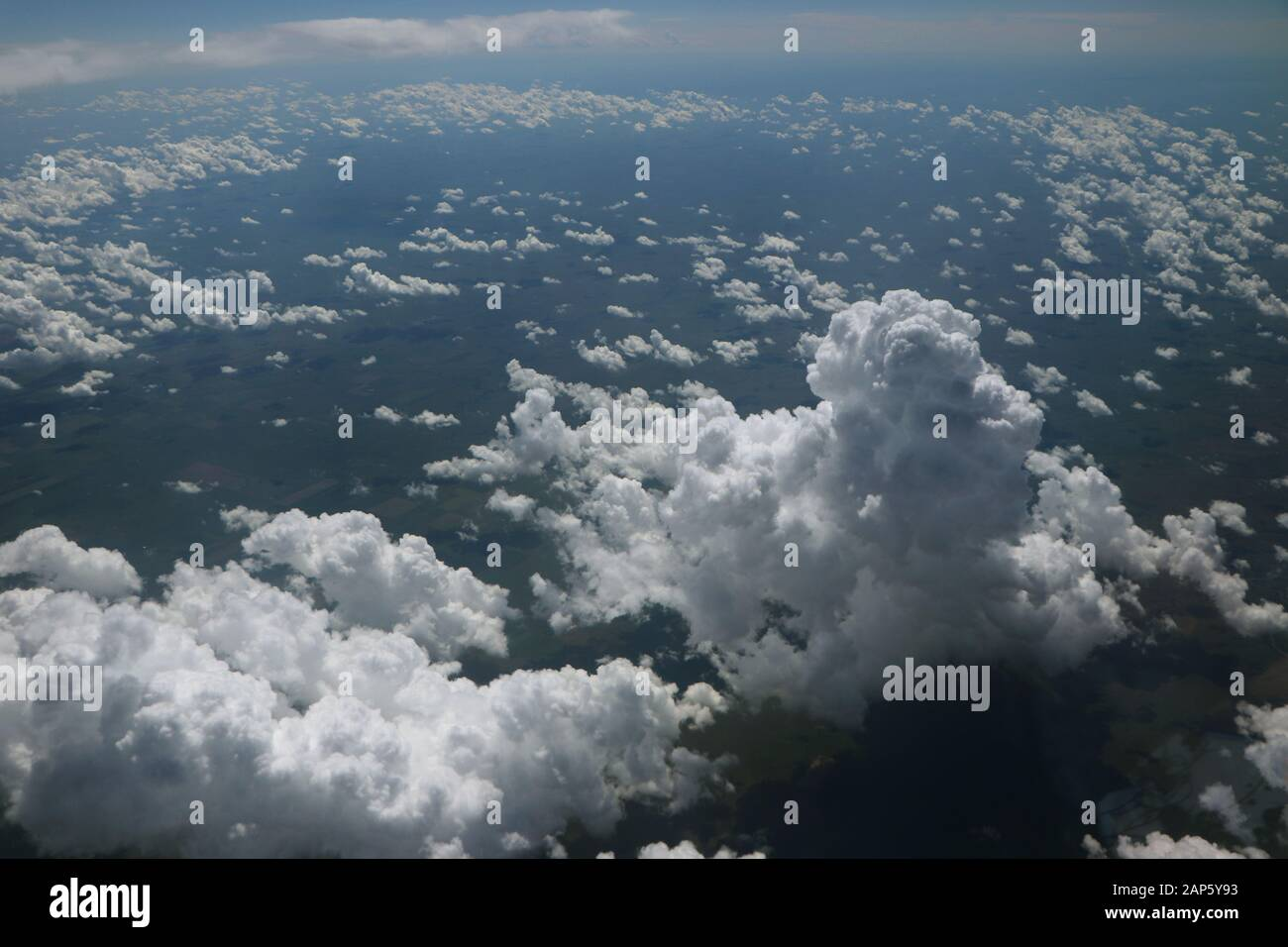 Cumulus clouds from airplane photograph from above Stock Photo