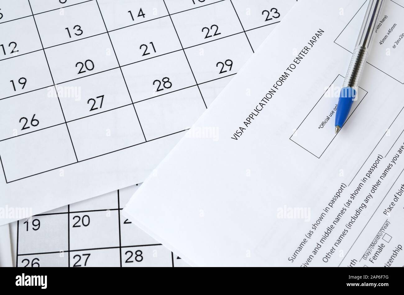 Visa Application Form To Enter Japan And Blue Pen On Paper Calendar Page Close Up Stock Photo Alamy
