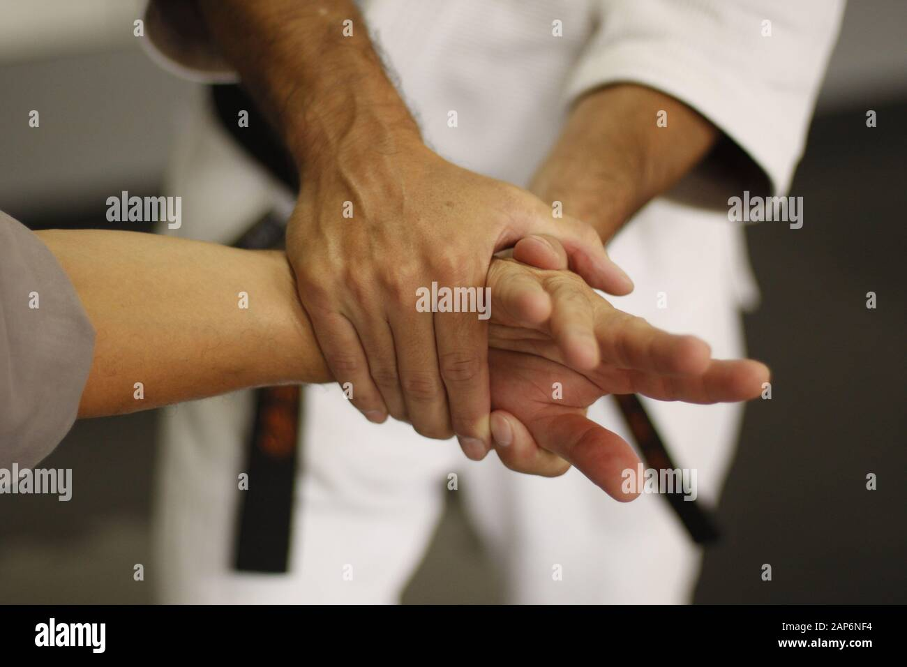 Close up of Kotegaeshi hand grabing technique in Aikido Stock Photo