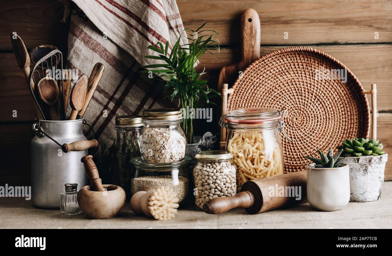 Eco Friendly Kitchen Concept Kitchen Cooking Utensils House Plants And Cooking Ingredients In Glass Jars Against Rustic Kitchen Wall Front View Stock Photo Alamy
