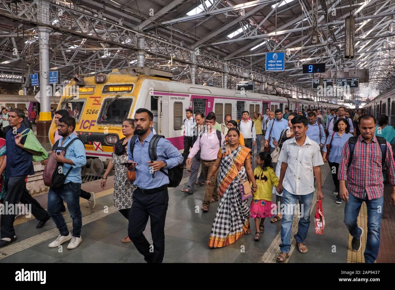Commuters at Chhatrapati Shivaji Maharaj Terminus in Mumbai, India, disembarking from a suburban train Stock Photo