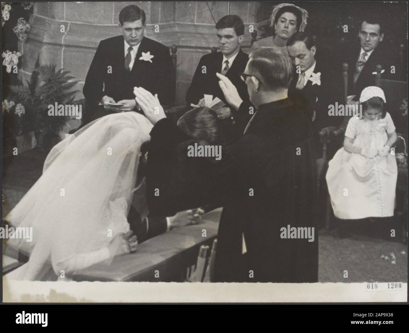 The blessing of marriage by prof. dr. H. Berkhof Date: January 10, 1967 Location: The Hague, South-Holland Keywords: marriages, churches, royal house, princesses, town halls Personal name: Berkhof H., Margriet, princess, Vollenhoven, Pieter van Stock Photo